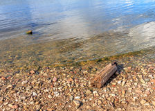 Stones and a piece of timber on the river bank. Russian river Volga Stock Photo