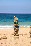 Stones piled on top of one another in Inuksuk fashion. In summer at the San Clemente State Beach in Southern California Stock Photography