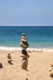 Stones piled on top of one another in Inuksuk fashion. In summer at the San Clemente State Beach in Southern California Royalty Free Stock Photos