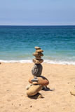 Stones piled on top of one another in Inuksuk fashion. In summer at the San Clemente State Beach in Southern California Stock Images