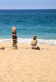Stones piled on top of one another in Inuksuk fashion. In summer at the San Clemente State Beach in Southern California Royalty Free Stock Images