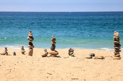 Stones piled on top of one another in Inuksuk fashion. In summer at the San Clemente State Beach in Southern California Royalty Free Stock Photo