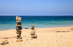Stones piled on top of one another in Inuksuk fashion. In summer at the San Clemente State Beach in Southern California Royalty Free Stock Photography