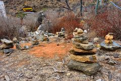 Stones piled up in prayer offerings in Paro, Bhutan royalty free stock image