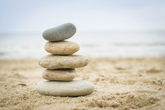 Stones piled up on a sand beach royalty free stock image