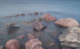 Stones and piles of jetty Royalty Free Stock Photography