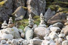 Stones piramida on the riverfront , Norway Royalty Free Stock Photos
