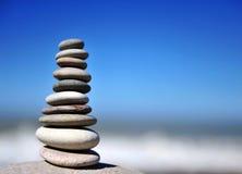 Stones pyramid on the beach Stock Photo