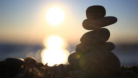 Stones pyramid on beach symbolizing zen, harmony stock footage