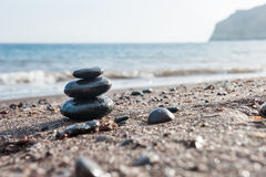 Stones pyramid on the beach. royalty free stock image