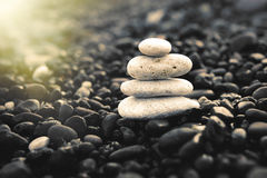 Stones pyramid on the beach. Zen and harmony concept. Royalty Free Stock Images