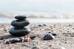 Stones pyramid on the beach stock photography
