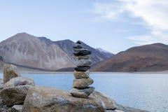 Stones pyramid on pebble beach symbolizing stability, zen, harmony, balance. at Pangong Lake. Leh-Ladakh, Jammu & Kashmir, Norther Royalty Free Stock Images