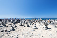 Stones pyramid on sand Royalty Free Stock Photo