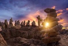 Stones pyramid on sand symbolizing zen, harmony, balance. Ocean. At sunset in Khao Lak Thailand Royalty Free Stock Photography