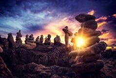 Stones pyramid on sand symbolizing zen, harmony, balance. Ocean. At sunset in Khao Lak Thailand Royalty Free Stock Photos