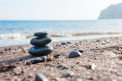 Stones pyramid on the sea coast royalty free stock photo
