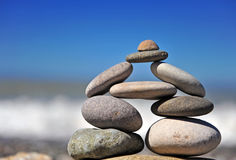 Stones pyramid standing at the sea Royalty Free Stock Photography