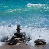 Stones pyramid in water splash Stock Photography