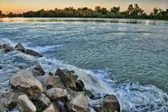 Stones among rapid water flow Stock Photography