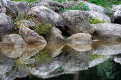 Stones reflection. In the water royalty free stock images