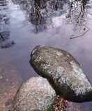 Untitled. Stones and reflections of trees in the water Royalty Free Stock Photo