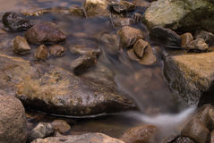 Stones in river. Big and small river's stones in mountain's stream Royalty Free Stock Photography