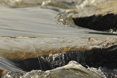 Stones in the river. Fast flowing water. Refreshing mountain river stream. The stream of crystal clear water Stock Photography