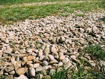 Stones on the road ore royalty free stock photos