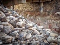 Stones. Rock embankment for a railway bridge stock image