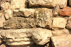 Stones rock poorody stacked together. In the form of a wall fragment Royalty Free Stock Image