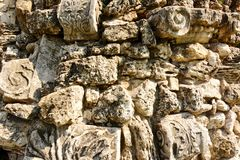 Stones rock poorody stacked together. In the form of a wall fragment Royalty Free Stock Photography