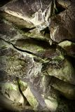 Wet old rocks with moss. Stones and rockes with moss, wet, solid and massive. Good as background Stock Photography