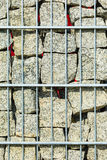 Stones and rocks in metal cage closeup Royalty Free Stock Photography