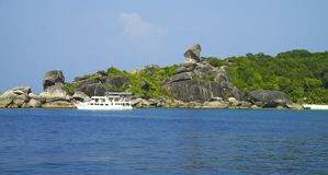 Stones and rocks paradise lagoon. White ship near big stones in lagoon. Seascape. Thailand. Andaman Sea stock photography