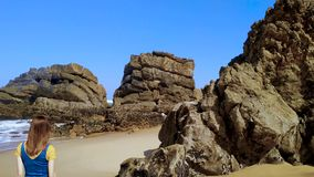 The rocky coast of Portugal, waves of Atlantic Ocean, sandy beach. Stones and rocks on sandy beach in Portugal the west Atlantic ocean, Adraga beach stock video