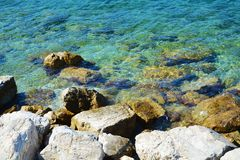 Stones, rocks and transparent water, background Royalty Free Stock Photo