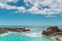 Stones and rocks in turquoise water. Mediterranean sea bay of Costa Brava. Lloret de Mar. Catalonia. Spain royalty free stock photos