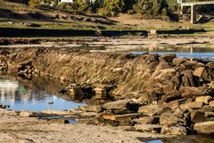 Stones in the reservoir. Stones and ruins in a dry reservoir in Portomarín. Spain Stock Photos