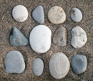 Stones on sand Stock Photo