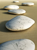 Stones in the sand Stock Photos