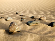 Stones in the sand Royalty Free Stock Images