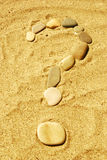 Stones on sand. Stones on sea sand, a background Royalty Free Stock Photography