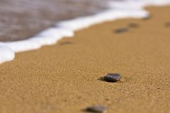 Stones on the sand. Little stones on the sand of a beach in Menorca Royalty Free Stock Photography