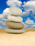 Stones in the sand against the sky close-up Royalty Free Stock Image