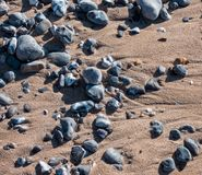Stones and sand on the beach.  royalty free stock images