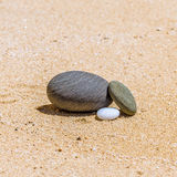 Stones in the sand on the beach Royalty Free Stock Photos