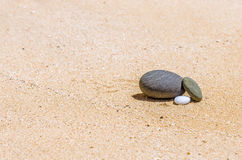 Stones in the sand on the beach Stock Images