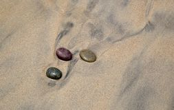 Stones in sand in California royalty free stock photography