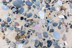 Stones in the sand on danish beach stock photos